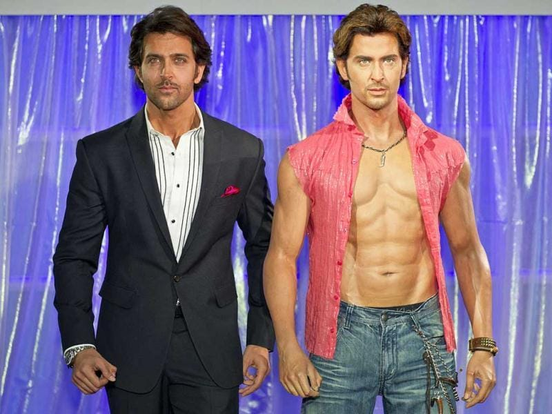 Hrithik Roshan tries to imitate his wax statue's stance, a replica of his Dhoom 2 character.