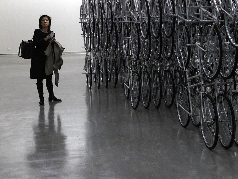 A visitor stands at an instillation entitled