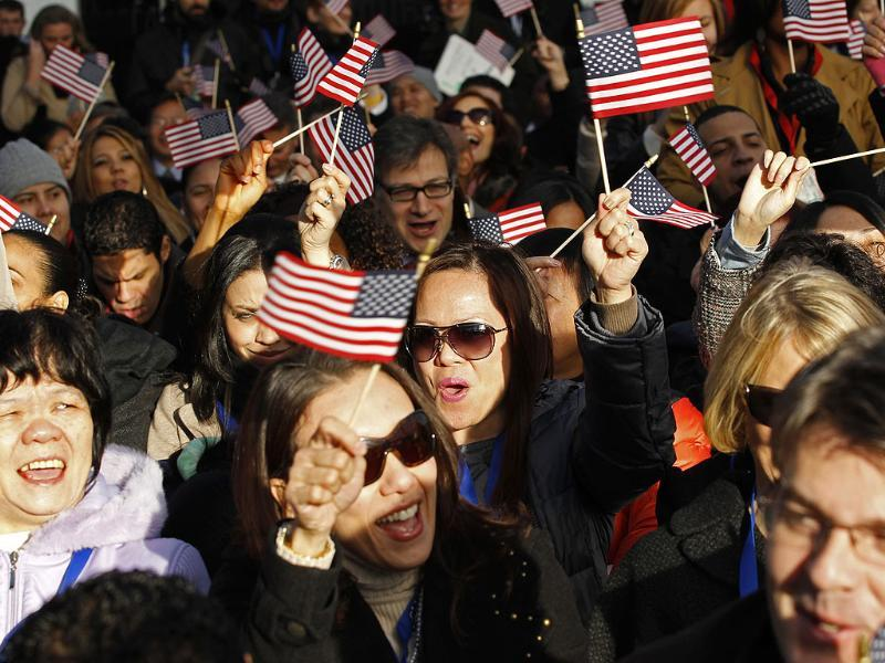 New US citizens celebrate after taking the oath of citizenship during a naturalization ceremony beneath the Statue of Liberty during ceremonies marking the 125th anniversary of the Statue at Liberty Island in New York. (Reuters/Mike Segar)