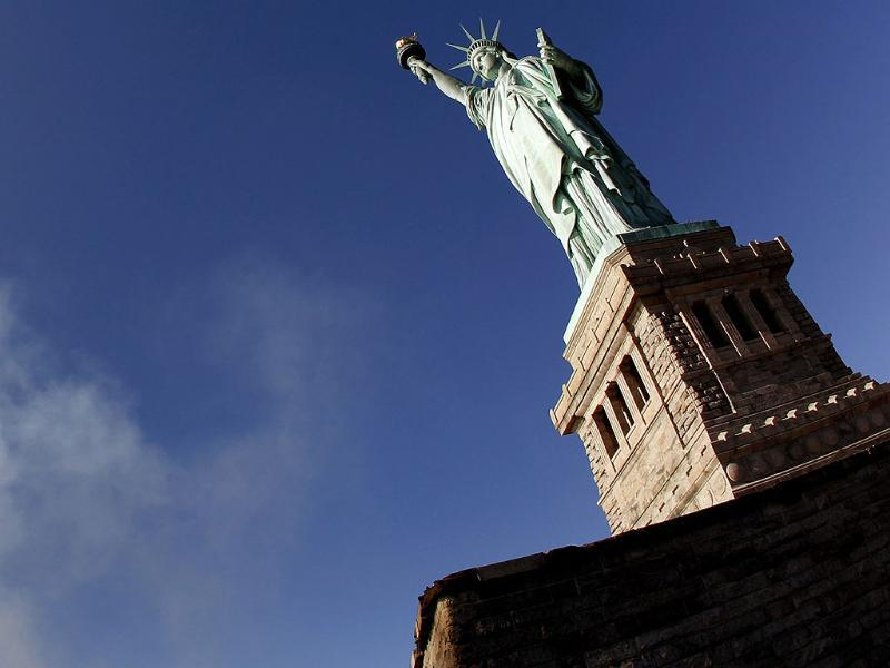 The Statue of Liberty is seen during ceremonies marking the 125th anniversary of the Statue at Liberty Island in New York. (Reuters/Mike Segar)