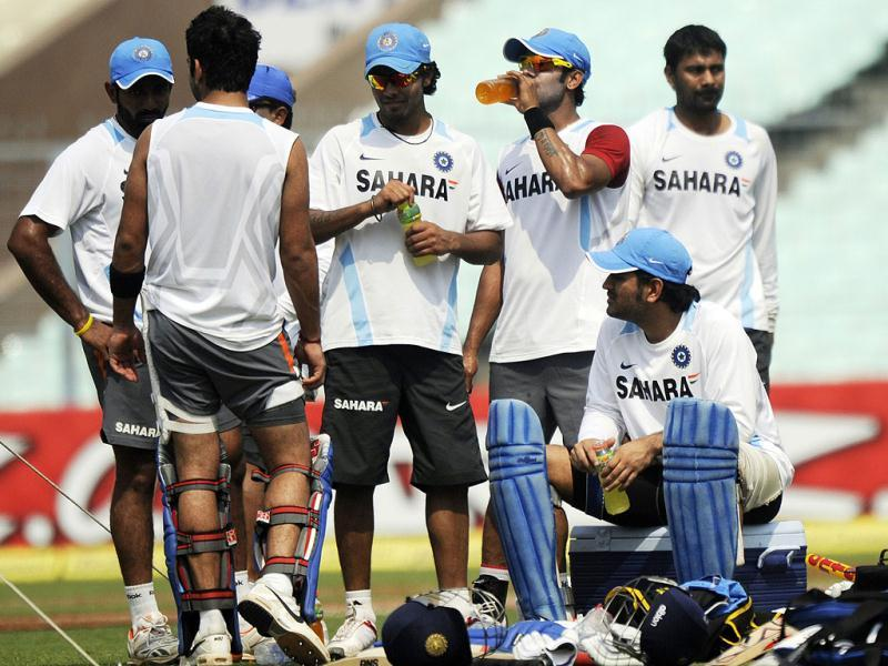 Indian cricket captain Mahendra Singh Dhoni (2R) and teammates take a break during a training session on the eve of the only Twenty20 match against England at the Eden Gardens in Kolkata. (AFP)