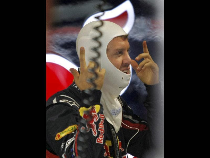 Red Bull drvier Sebastian Vettel prepares for the third practice ahead of Sunday's Indian Formula One Grand Prix at the Buddh International Circuit in Greater Noida.