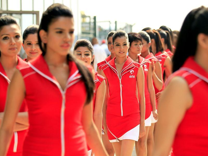 The grid girls march ahead of Sunday's Indian Formula One Grand Prix at the Buddh International Circuit in Noida.