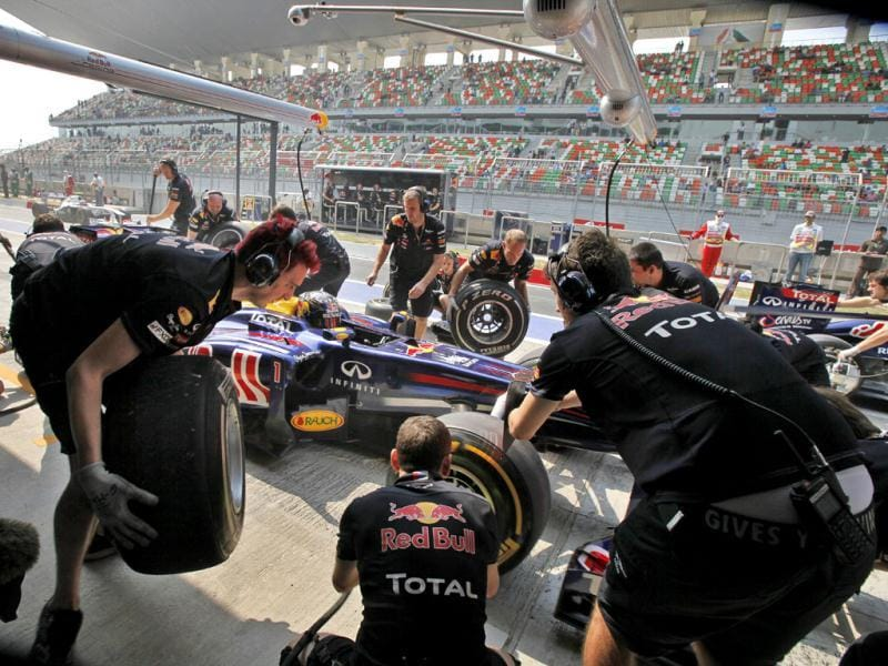 Red Bull driver Sebastian Vettel of Germany's car gets a pit service during the third practice session ahead of Sunday's Indian Formula One Grand Prix at the Buddh International Circuit in Noida.