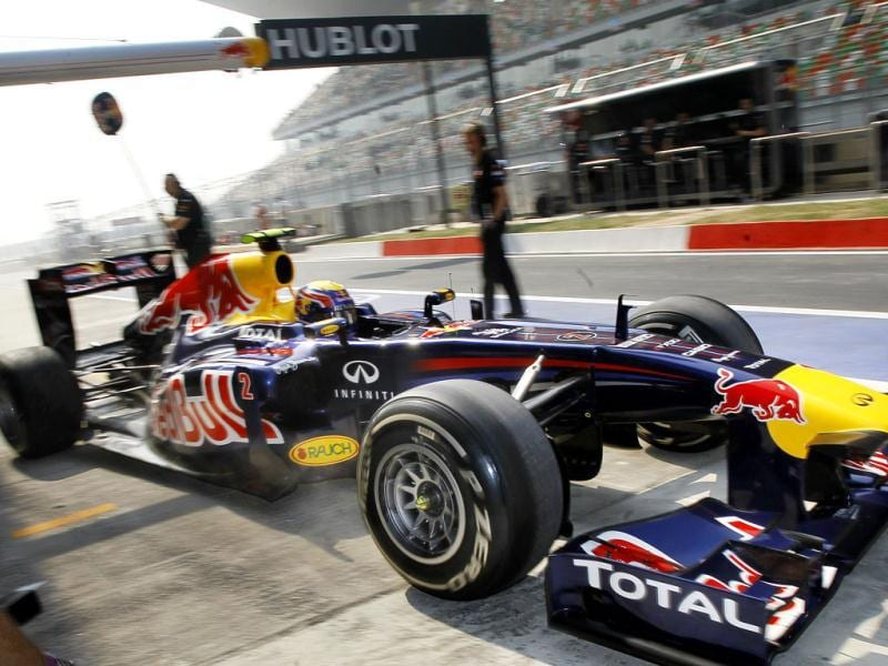 Red Bull driver Mark Webber of Australia returns to the pit lane during the third practice session ahead of Sunday's Indian Formula One Grand Prix at the Buddh International Circuit in Noida.