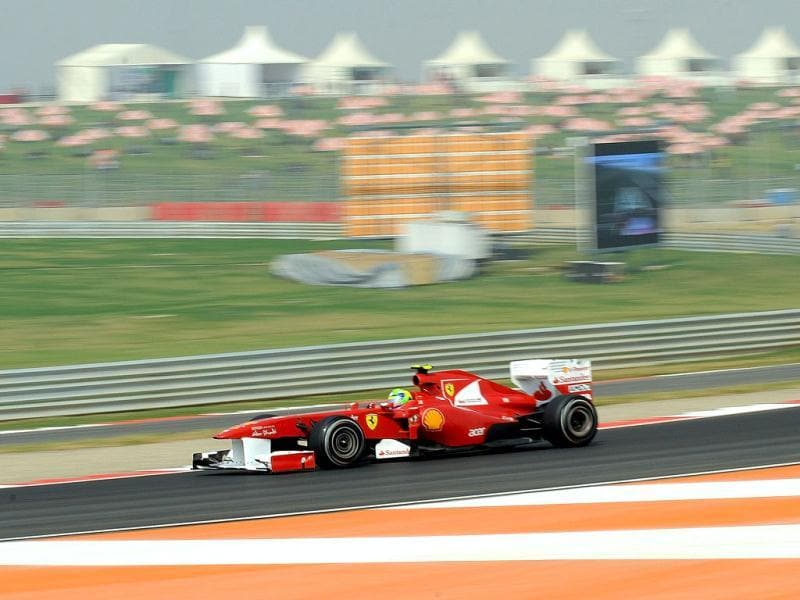 Ferrari driver Felipe Massa of Brazil powers his car during the third practise sessions of Formula One Indian Grand Prix at the Buddh International circuit in Greater Noida.