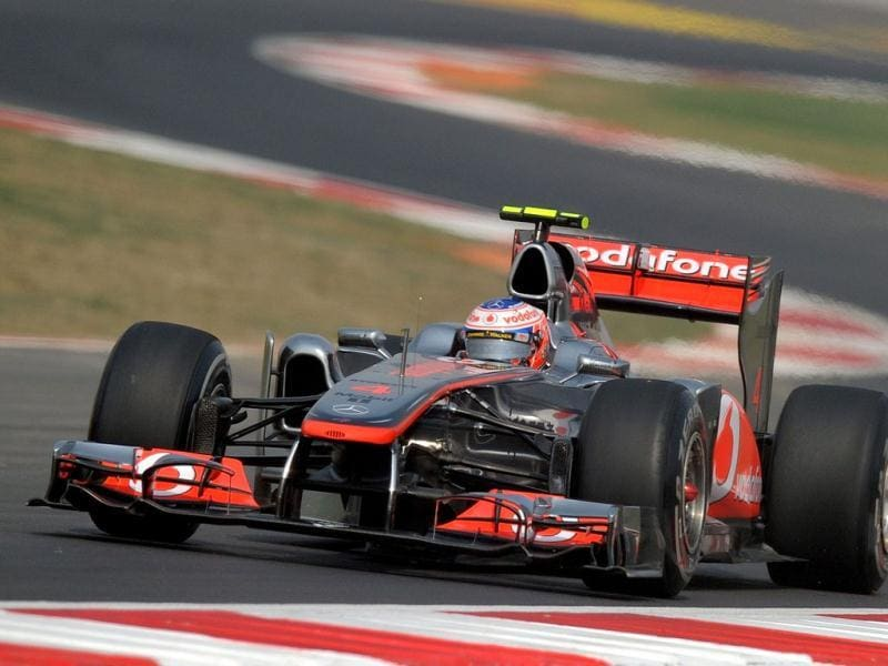 McLaren-Mercedes driver Jenson Button of Britain powers his car during the third practise session of the Formula One Indian Grand Prix in Greater Noida.