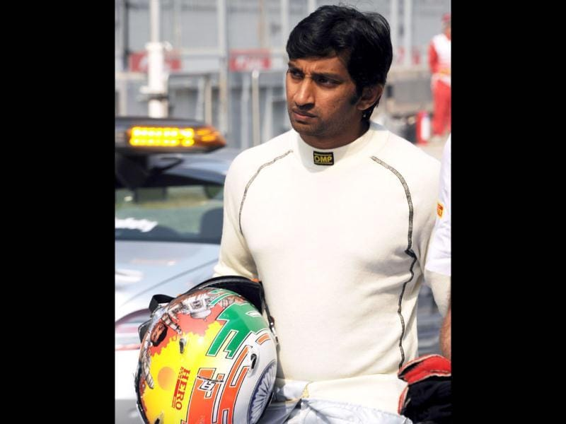 Hispania-Cosworth driver Narain Karthikekyan of India walks on the pit lane prior to the third practice session of Formula One's Indian Grand Prix at the Buddh International circuit in Greater Noida.