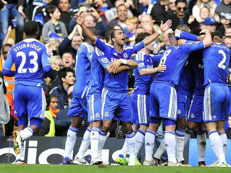 Chelsea's players celebrate John Terry's goal during the English Premier League football match against Arsenal at Stamford Bridge in London. (AFP)