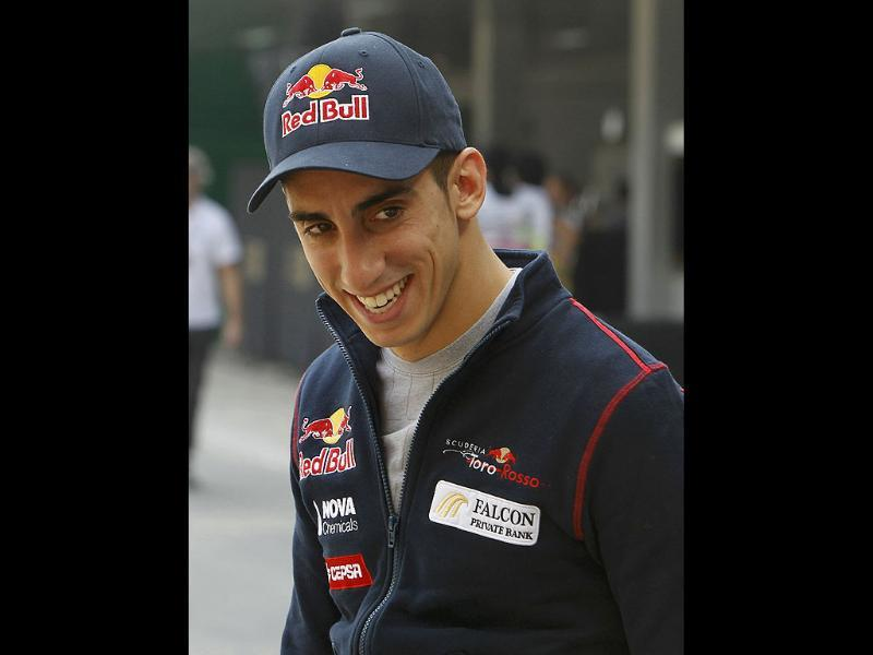 Toro Rosso Formula One driver Sebastien Buemi of Switzerland smiles as he arrives in the paddock area at the Buddh International Circuit in Greater Noida. (Photo: Reuters)
