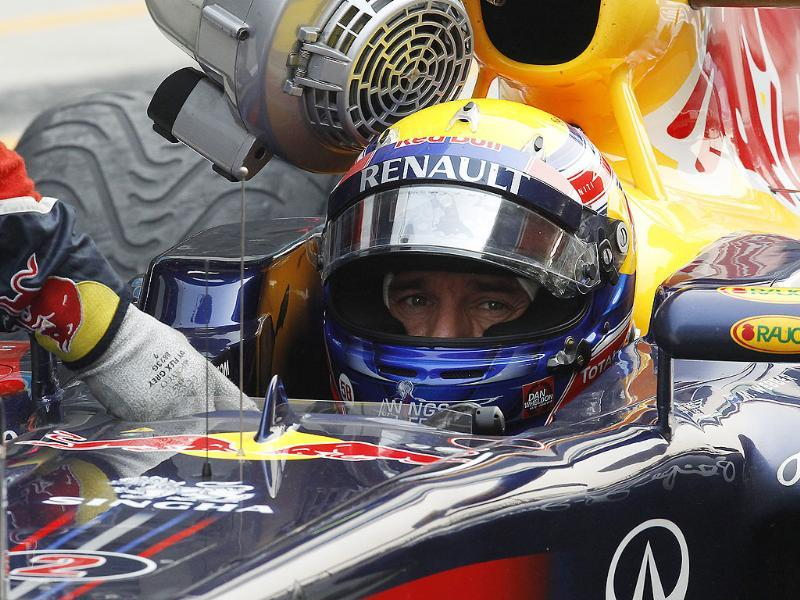 Crews push the car driven by Red Bull driver Mark Webber of Australia during the qualifying for Indian Formula One Grand Prix at the Buddh International Circuit in Greater Noida. (Photo: AP)