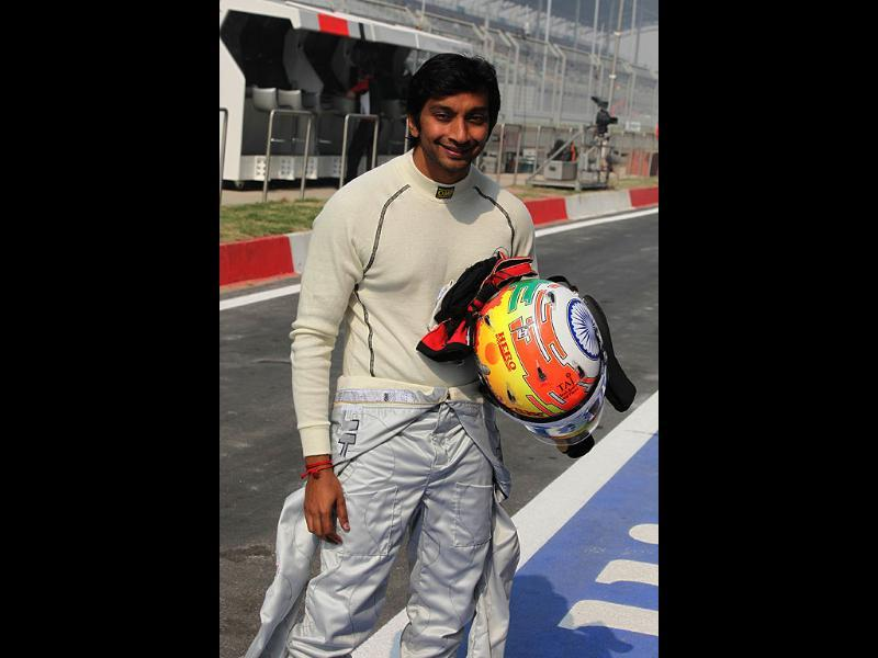 HRT-Cosworth driver Narain Karthikeyan smiles during the 3rd practice session of Indian Grand Prix at the Buddh International Circuit in Greater Noida, Uttar Pradesh. (HT Photo by Virendra Singh Gosain)