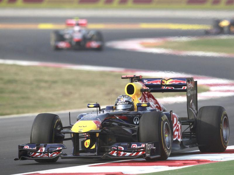 Red Bull Formula One driver Sebastian Vettel of Germany leads during the Indian first Formula One Grand Prix at the Buddh International Circuit in Greater Noida.