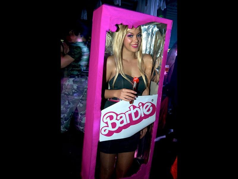 A woman dressed up as a Barbie doll poses during a Halloween Eve Party in Belgrade. Halloween is based on the Celtic festival of Samhain and the ancient Celts believed the border between this world and the otherworld became thin on that night, allowing spirits to pass through. (AFP Photo)