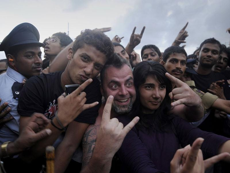 Fans reacts during the concert of US heavy metal band Metallica, in Bangalore.