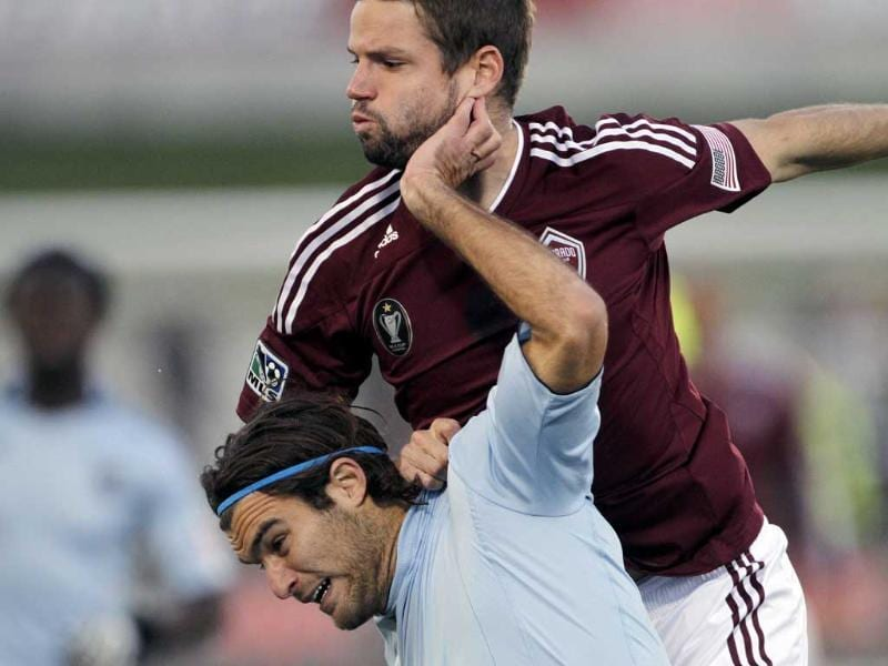 Colorado Rapids defender Drew Moor (3) and Sporting Kansas City's Graham Zusi compete for the ball during the first half of the first game in the Eastern Conference semifinal playoff series MLS soccer match.