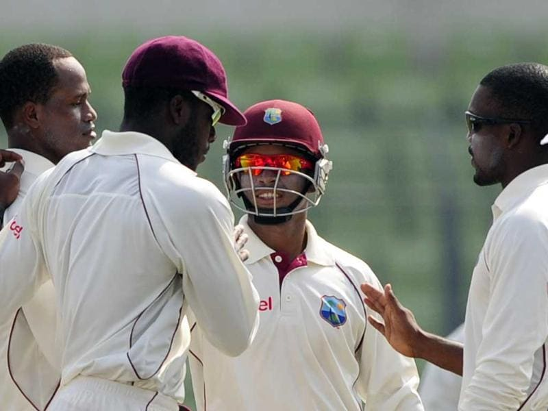 West Indies cricketers congratulate teammate Marlon Samuels (L) after the dismissal of Bangladeshi batsman Nasir Hossain during the third day of their second cricket Test match at the Sher-e-Bangla National Cricket Stadium in Dhaka.