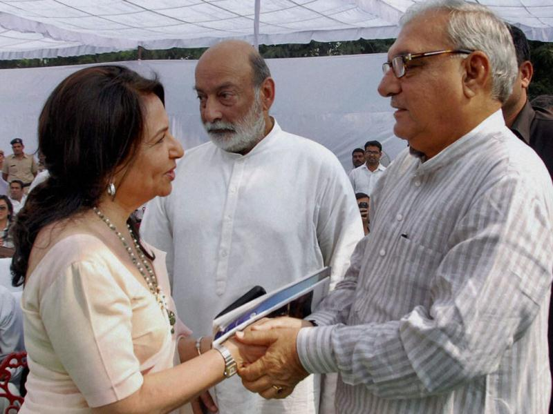 Sharmila Tagore in conversation with the Chief Minister of Haryana, Bhupinder Singh Hooda.