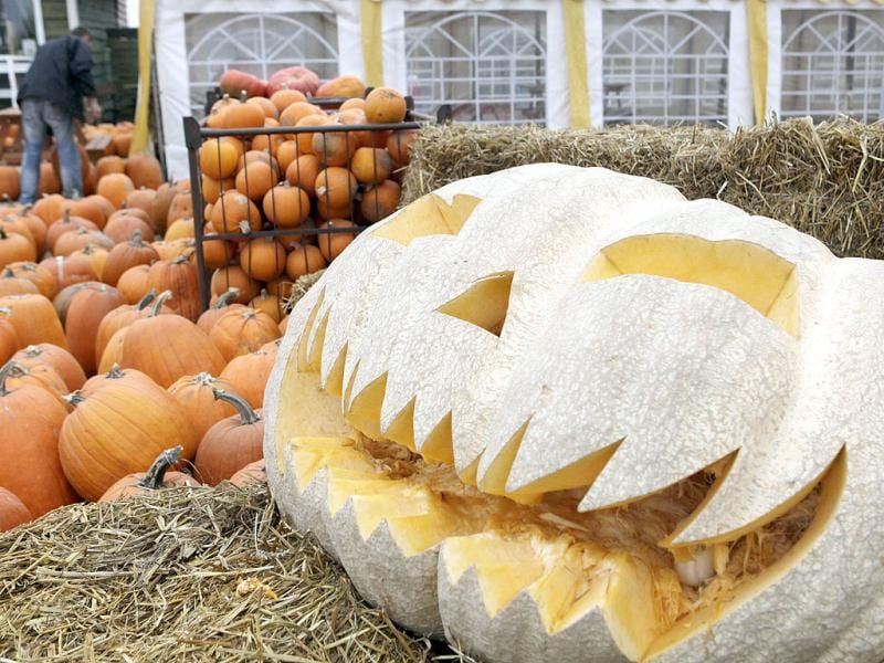 Carved pumpkins are seen on offer at a roadside stall for Halloween near Warsaw, Poland.