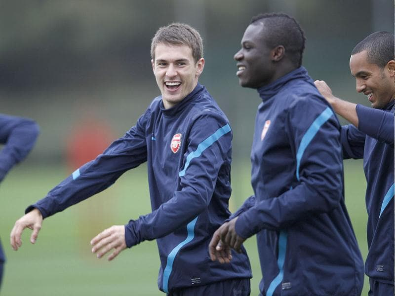 Arsenal's Aaron Ramsey (L) and Emmanuel Frimpong (C) attend a team training session in London Colney. Arsenal are due to play Olympique Marseille in their Champions League Group F soccer match on Tuesday in London.