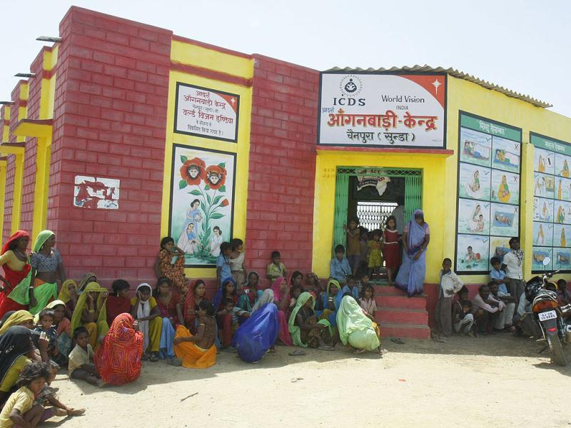 Sahariya women and children wait outside an anganwadi in Chainpur, Baran district. Rajasthan's 90,000 Sahariya tribals are among the India's poorest people.