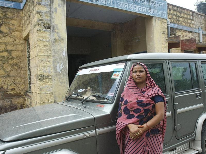 Nirmala Sahariya, member of the legislative assembly from Kishanganj-Shahbad, stands alongside her Bolero car in Baran district. Rajasthan government officials admit they have been unable to utilise the entire funds meant for the Sahariya community but they have excuses. As one official said: the