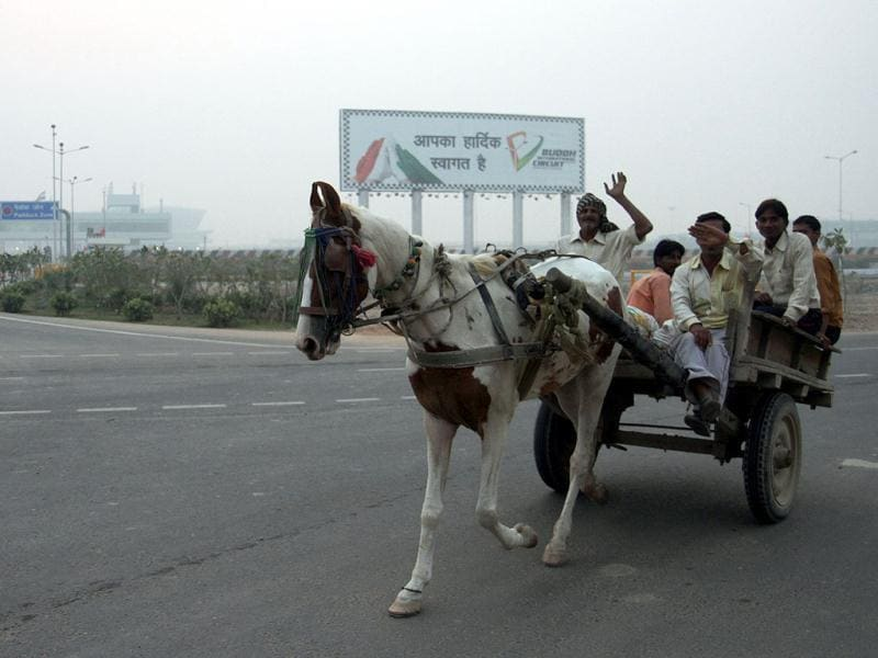 Locals on bullock cart pass by International Buddh Circuit a day after Indian Grand Prix event was held at Greater Noida. HT Photo by Mohd Zakir