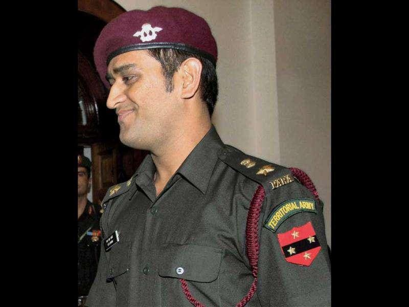 MS Dhoni during the pinning ceremony in New Delhi today following grant of honorary rank of Lt Colonel in the Territorial Army.
