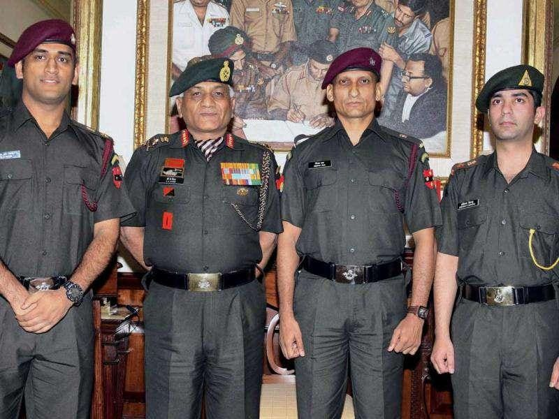 Army chief Gen VK Singh with cricketer MS Dhoni, shooter Abhinav Bindra and combat specialist Deepak Annaji Rao during the pinning ceremony in New Delhi today after they were granted honorary ranks in the Territorial Army.