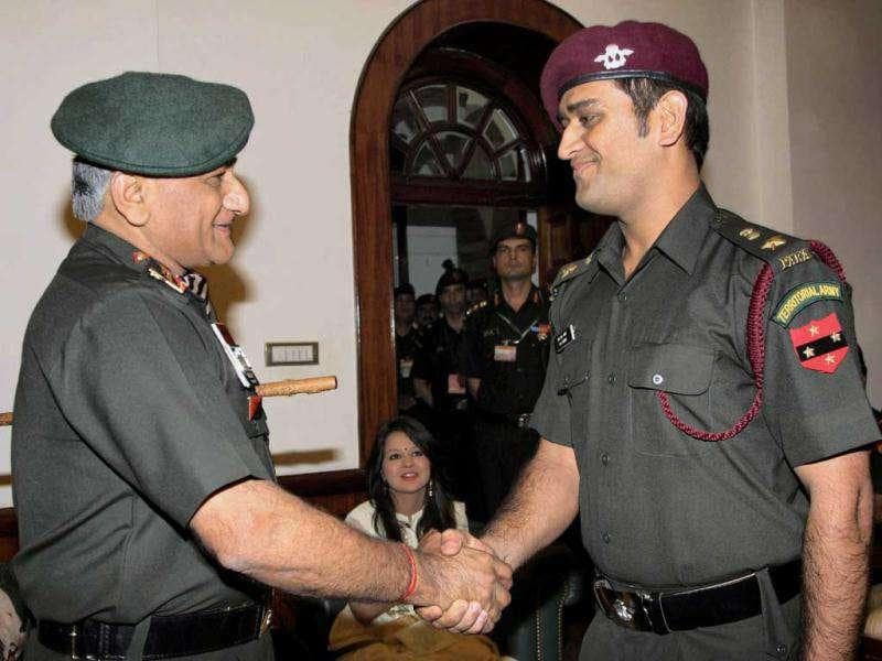 Army chief Gen VK Singh (L) greets MS Dhoni during the pinning ceremony in New Delhi on Tuesday following grant of honorary rank of Lt Colonel in the Territorial Army.