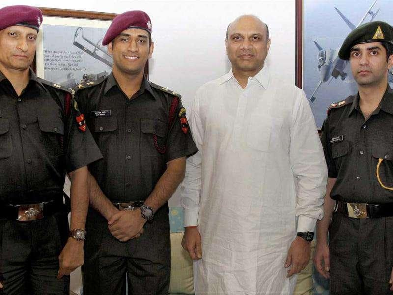 MS Dhoni and Abhinav Bindra meet MoS for Defence MM Pallam Raju in New Delhi today after they were granted honorary rank of Lieutenant Colonel in the Territorial Army.