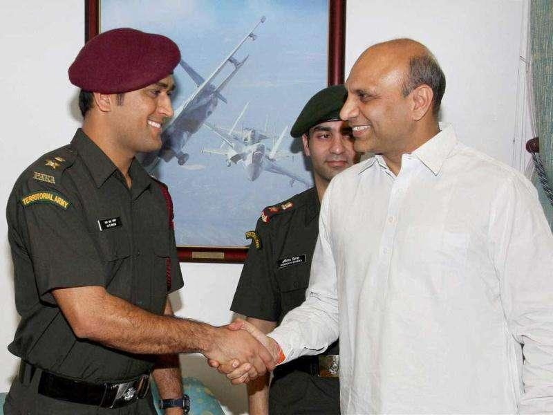 Cricketer MS Dhoni and Shooter Abhinav Bindra meet MoS for Defence MM Pallam Raju in New Delhi today after they were granted honorary rank of Lieutenant Colonel in the Territorial Army.