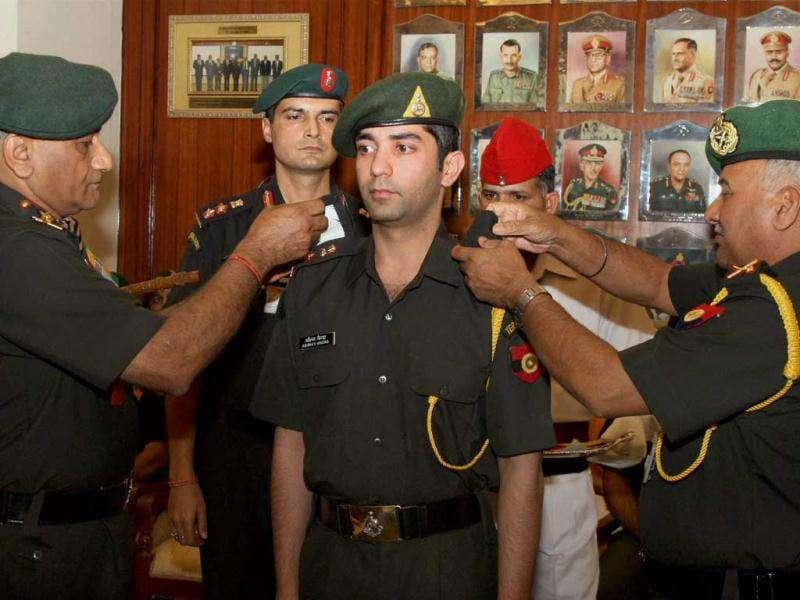 Army chief Gen VK Singh pinning badges on shooter Abhinav Bindra in New Delhi today after he was granted honorary rank of Lt Colonel in the Territorial Army.