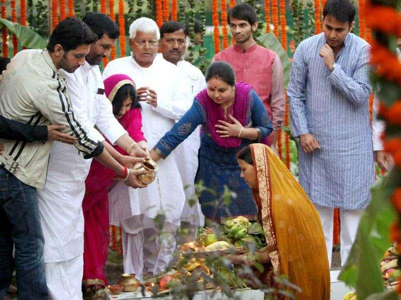 RJD chief Lalu Prasad Yadav, his wife Rabri Devi and LJP President Ramvilas Paswan, with his family, performing Chhath puja at Lalu's residence in New Delhi.