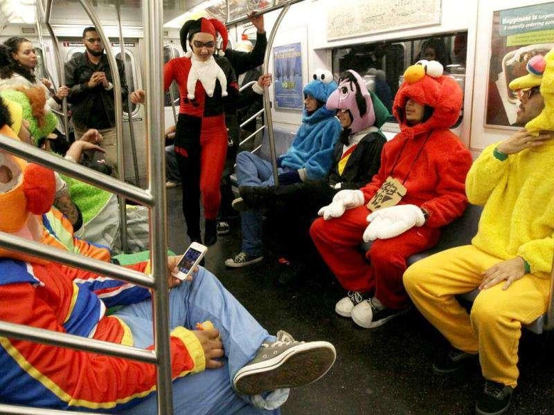 A group of friends dressed as Sesame Street characters, including Victor Morales, dressed as Big Bird, right, take the 6 train early Tuesday morning after attending the Village Halloween Parade in New York.