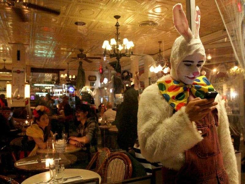 Dressed as a Rabbit, Mike Mikulewich waits outside a restaurant after participating in the Village Halloween Parade in New York.