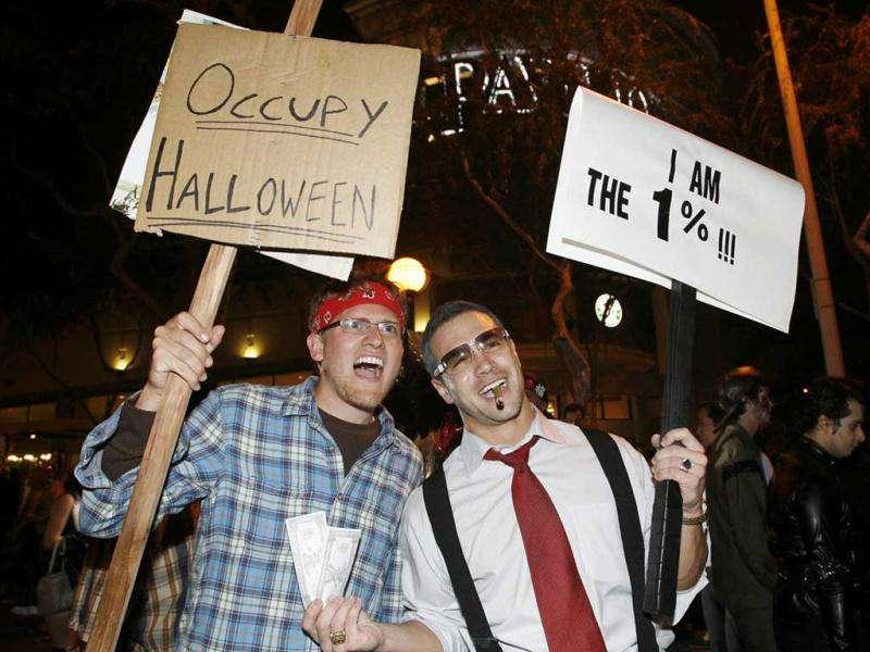 Nathan Harris (L) and Matt Briskie, both from Los Angeles, pose as a Occupy Wall Street protester and a member of the richest one percent respectively, at the West Hollywood Halloween Costume Carnaval in West Hollywood, California. Officials estimate that 400,000 people would attend what is described as one of the world's largest annual Halloween celebrations.