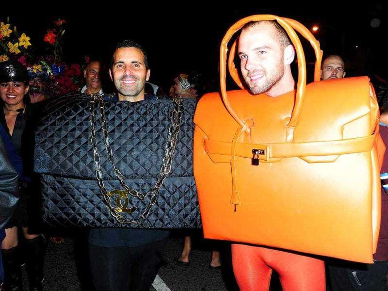 Two men dressed as designer handbags attend the West Hollywood Halloween Carnavale in West Hollywood, California.