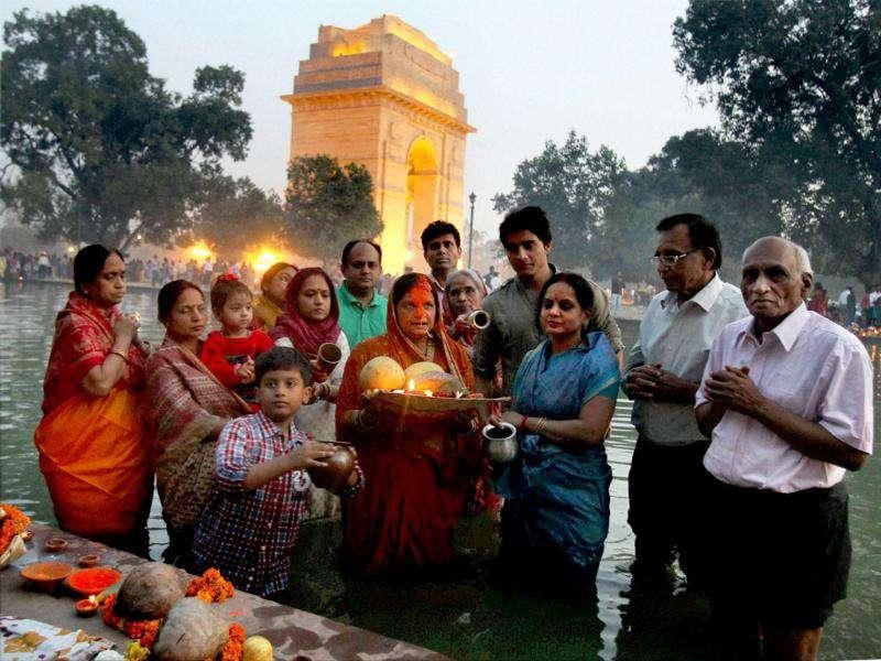 People observe the festival of Chhath Puja near India Gate in New Delh.