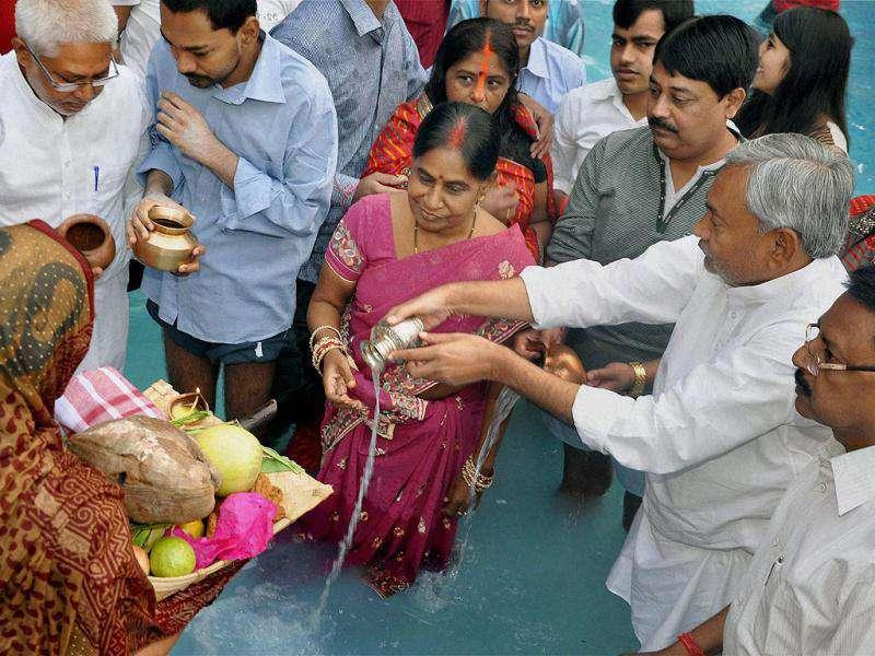 Bihar chief minister Nitish Kumar along with his family performs worship of Lord Sun on the occasion of Chhath festival at his residence in Patna.
