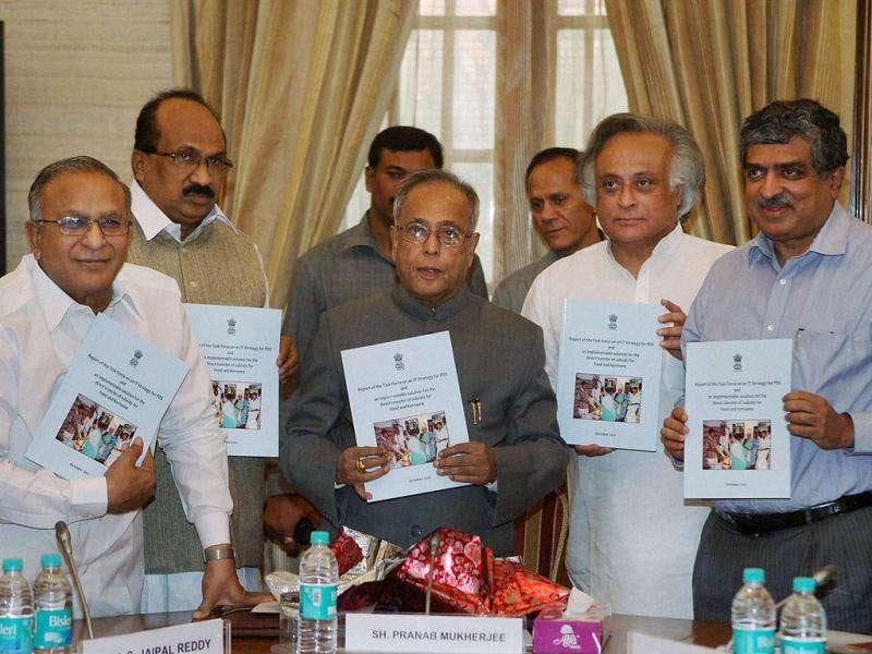 Finance minister Pranab Mukherjee with Petroleum minister S Jaipal Reddy, Rural Development minister Jairam Ramesh and UIDAI chairman Nandan Nilekani releasing the report of the task force on IT strategy for PDS and implementable solution for direct transfer of subsidies in New Delhi.