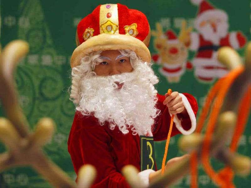 A participant takes part in the Hong Kong round of the Santa Claus Winter Games at a shopping mall in Hong Kong. Hong Kong won the championship in 2009 and came in third in 2010 for the international competition held annually in Gaellivare, Sweden.