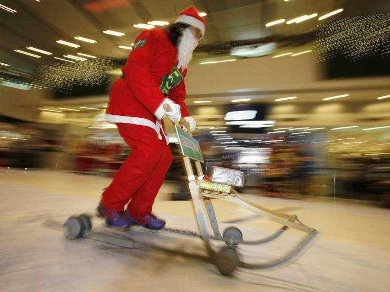 A participant transports parcels during the Hong Kong round of the Santa Claus Winter Games at a shopping mall in Hong Kong. Hong Kong won the championship in 2009 and came in third in 2010 for the international competition held annually in Gaellivare, Sweden.