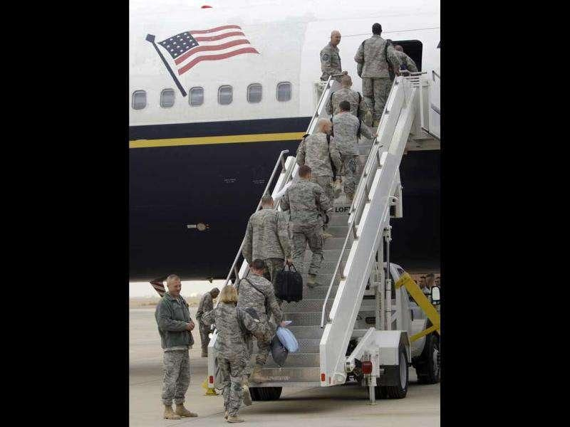 US army soldiers begin their journey home at al-Asad Air Base west of Baghdad, Iraq. The US has promised to withdraw from Iraq by the end of the year as required by a 2008 security agreement between Washington and Baghdad. Some 39,000 US troops are scheduled to clear out along with their equipment.
