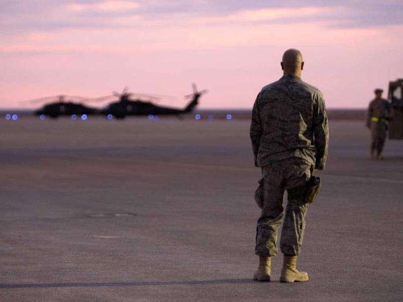 A US soldier stands on the tarmac before making his journey home from al-Asad airbase west of Baghdad, Iraq.