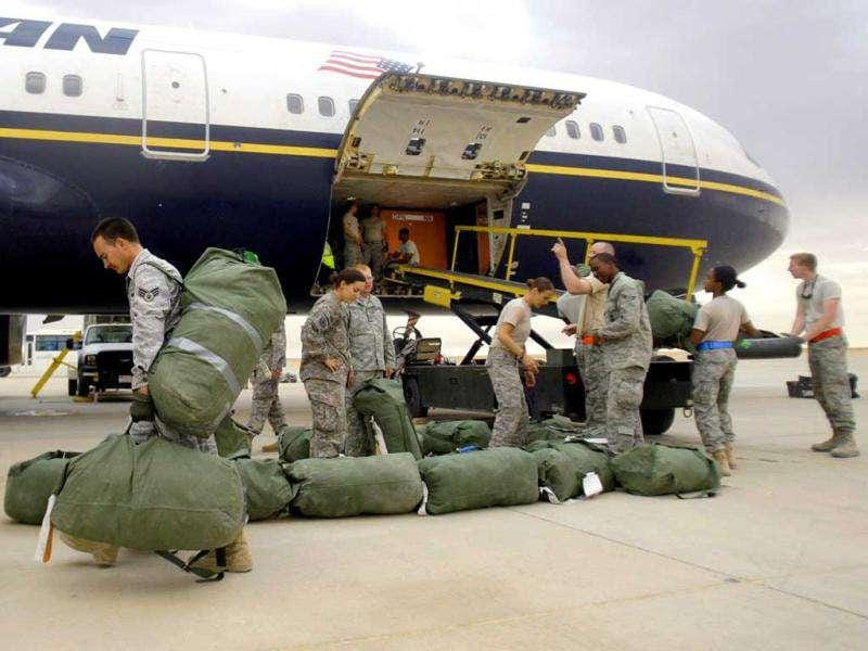 U. army soldiers carry their luggage as they begin their journey home at al-Asad Air Base west of Baghdad, Iraq.