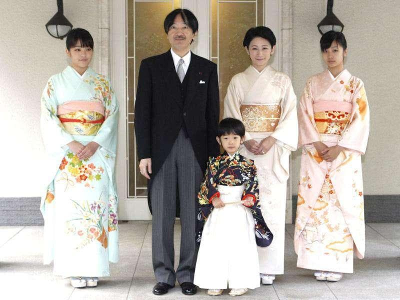Japan's Prince Hisahito (C) wearing traditional ceremonial attire is accompanied by his father Prince Akishino (2nd L), mother Princess Kiko (centre R) and sisters Princess Mako (L) Princess Kako (R) after the Chakko-no-Gi and Fukasogi-no-gi ceremonies at the Akasaka imperial estate in Tokyo.