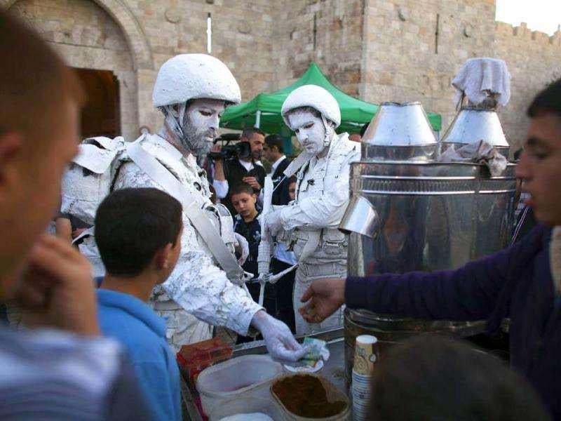 Artists Yuda Braun and Jonathan Pelleg, buy tea by the Jerusalem's Old City's Damascus Gate as a part of performance titled