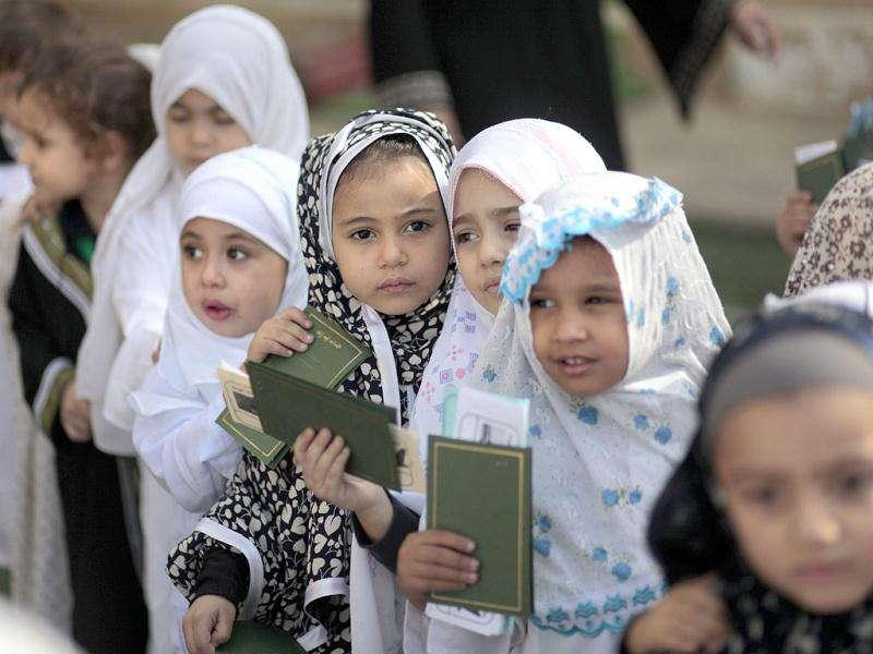 Egyptian kindergarten children of the Degla Azharian language school in Cairo, Egypt, hold their mock passports, as they simulate a pilgrimage to Mecca in Saudi Arabia to attend the Hajj, a day ahead of the start of the hajj, one of the biggest annual events in the world. The hajj is a pilgrimage to Mecca, a religious duty that Muslims aspire to do at least once in their lifetime.