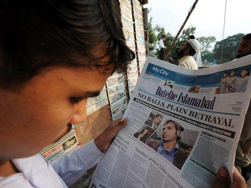 A man reads a newspaper featuring coverage of Pakistani cricketers jailed in the UK over match-fixing, at a roadside stall in Islamabad. A British judge jailed disgraced former Pakistan cricket captain Salman Butt, two of his bowlers and their agent for their part in a fixing scandal which rocked the international game to its core.